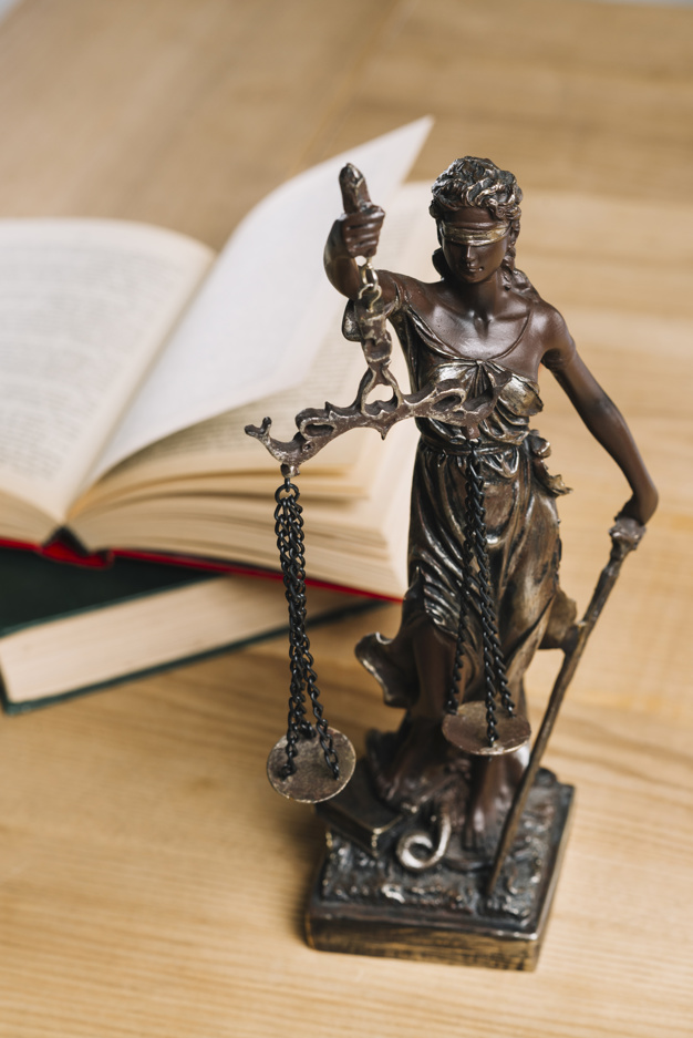 lady-justice-law-books-wooden-table_23-2147898227
